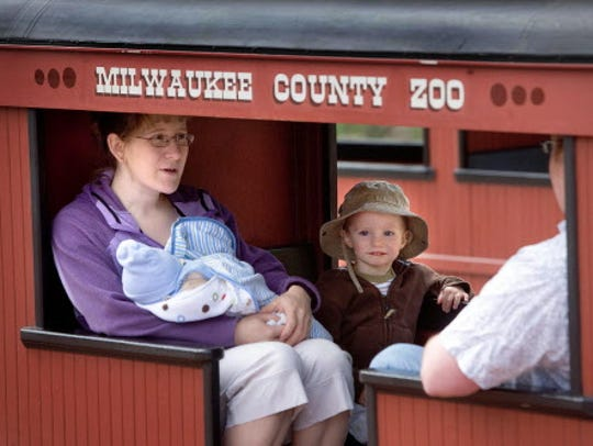 Lisa Prechel, of Pewaukee, takes her family on a train