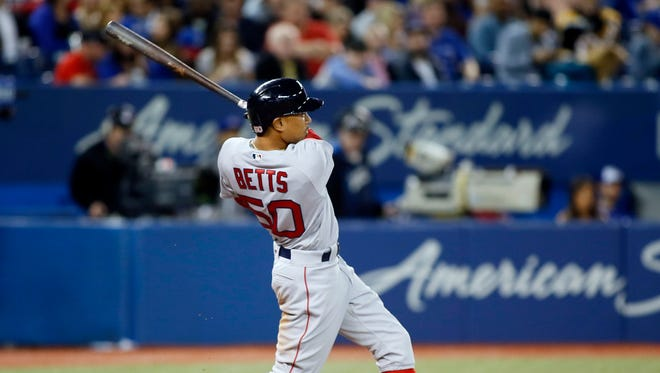 Mookie Betts connects for his first home run of 2017, against the Toronto Blue Jays on Tuesday night.