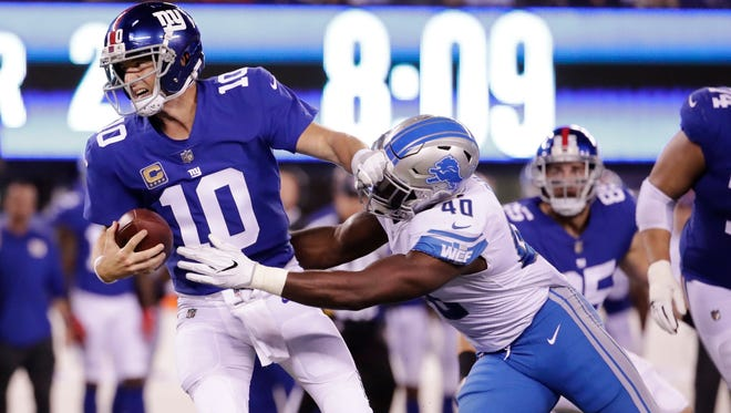 Giants quarterback Eli Manning is sacked by Lions linebacker Jarrad Davis in the first half Monday, Sept. 18, 2017 in East Rutherford, N.J.