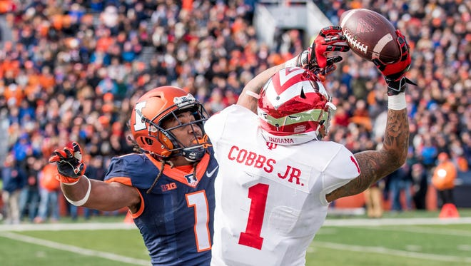 Indiana wide receiver Simmie Cobbs Jr. (1) makes a catch over Illinois defensive back Jaylen Dunlap (1) during the second quarter of an NCAA college football game Saturday, Nov. 11, 2017, at Memorial Stadium in Champaign, Ill.