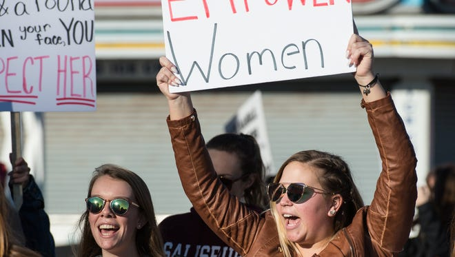 Salisbury University Student, Julia Mann, right, marches during the Empowering Women: Women's March Reunion Rally on Sunday, Jan. 21, 2018.