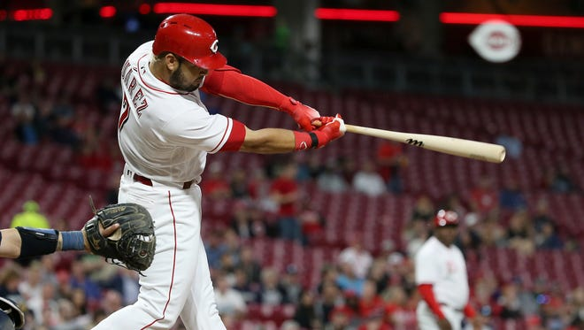 Cincinnati Reds third baseman Eugenio Suarez (7) hits a two-run single in the fifth inning during a National League baseball game between the Milwaukee Brewers and the Cincinnati Reds, Monday, April 30, 2018, at Great American Ball Park in Cincinnati.