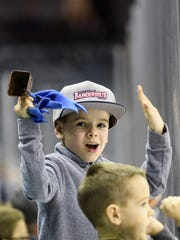 """From top, Jacob, 9, and Caleb Cerklefskie, 5, cheer for the Evansville Thunderbolts as they take on the Knoxville Ice Bears at the Ford Center in Evansville on March 30. Their grandparents, Ken and Kathy Cerklefskie, brought the boys to the game to have some fun and """"tire them out."""" The boys were visiting Evansville from Ohio during their Spring Break school vacation."""