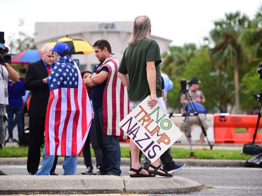 Protesters stand outside of the Curtis M. Phillips Center for the Performing Arts in Gainesville awaiting the arrival of alt-right leader Richard Spencer in Gainesville on Thursday.