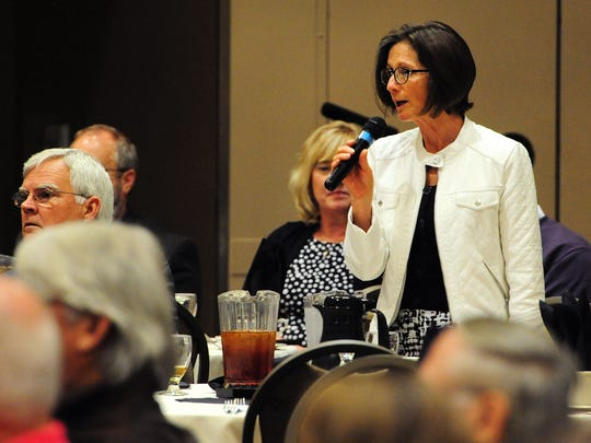 Raquel Moore-Green, of the Salem City Club, asks mayor Anna Peterson a question during the State of the City address at the Salem Convention Center, on Wednesday, May 20, 2015, in Salem.