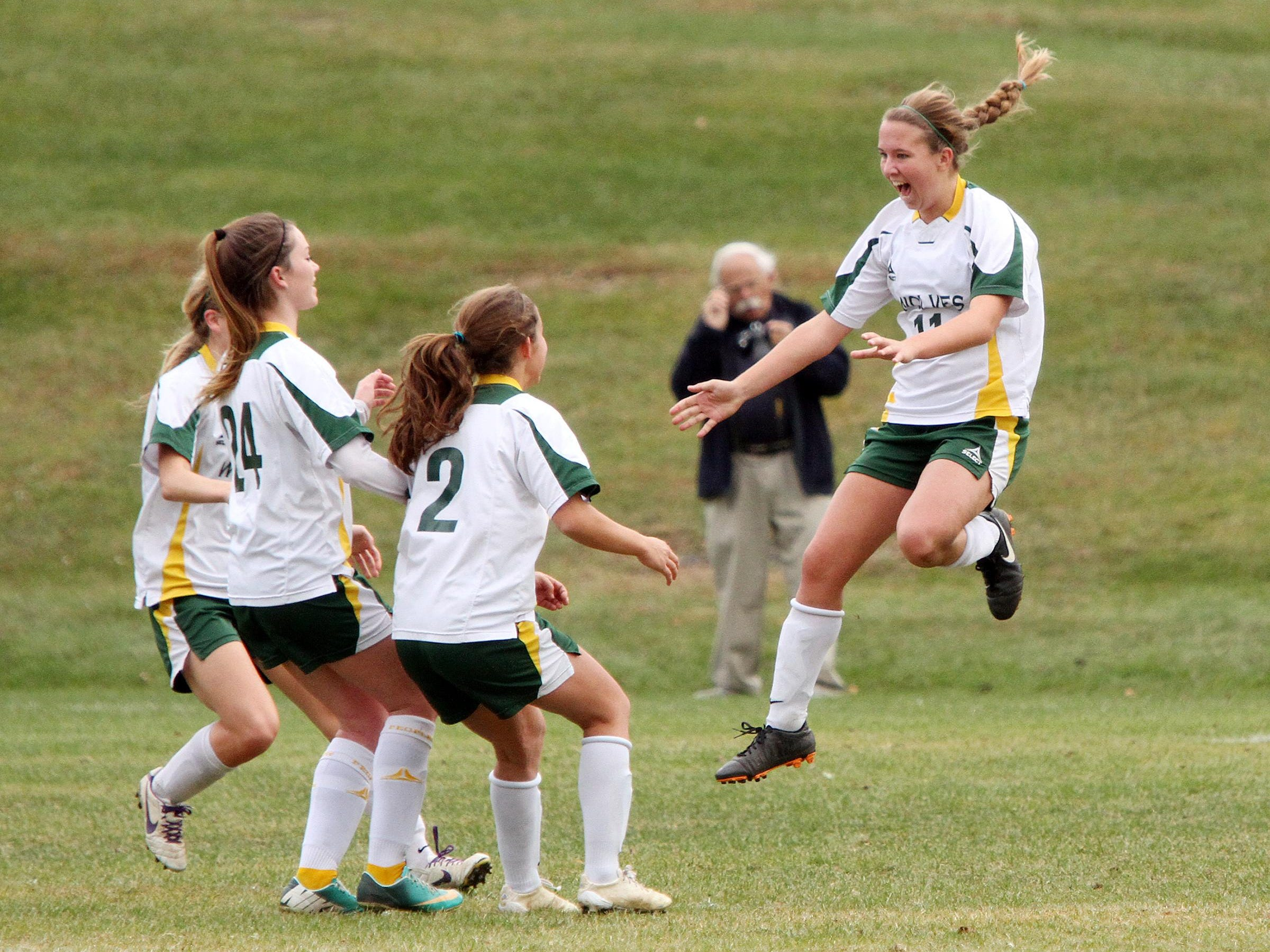 Peoples Academy's Katie Stames leaps in celebration after her penalty kick goal in the second half of the Wolves' 4-1 win over Thetford in the Division III girls soccer state championship game at Williamtown High School on Saturday.