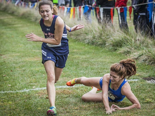 Blue River's Logan McRoberts (left) and Union City's Emma Baron fight to cross the finish line during the Eagle Invitational Saturday morning.