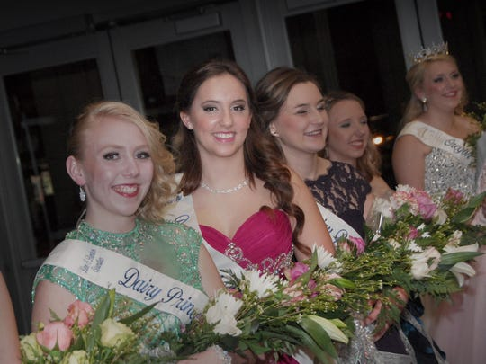 Gina Atsma, of Amity, representing Polk County in the Oregon Dairy Princess-Ambassador program (in red dress), is flanked by Olivia Miller of Independence at her right and Sara Pierson of St. Paul, Stephanie Breazile of Hillsboro and Emma Miller of Independence at her left. The women were awaiting the Oregon Dairy Princess-Ambassador program coronation program to begin at the Salem Convention Center.