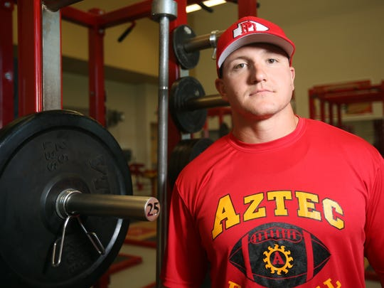 Palm Desert High School's new football coach Shane McComb is photographed on Tuesday, May 10, 2016, in the school's weight room. McComb played against Palm Desert during his high school football career in Hemet.