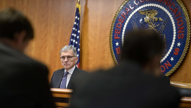 Federal Communication Commission (FCC) Chairman Tom Wheeler waits for a hearing at the FCC December 11, 2014 in Washington, DC.