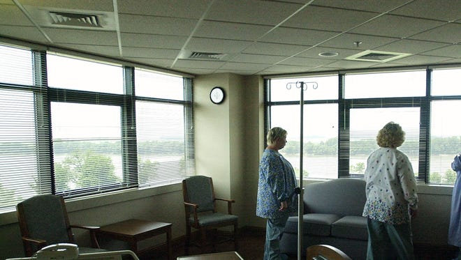 In this file photo from 2002, Methodist Hospital employees check out the view from one of the deluxe private rooms in the hospital's new telemetry unit. (Gleaner photo by Mike Lawrence)