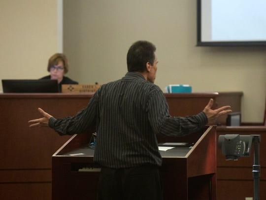 Defendant Rick Stallings speaks to District Chief Judge Karen Townsend Thursday during his murder trial at Aztec District Court.