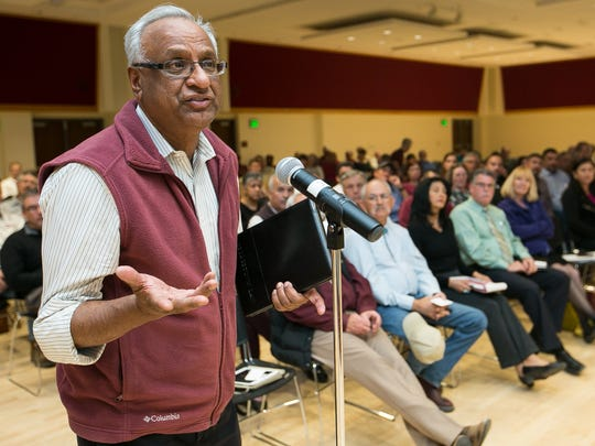 New Mexico State University department of chemistry and biochemistry professor Amudhu Gopalan speaks on Wednesday, March 9, 2016, during the question and answer portion of a budget town hall meeting hosted by NMSU President Garrey Carruthers.