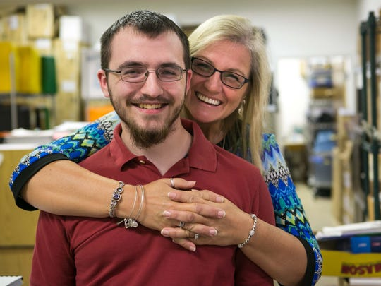 Gwen Griffith and her son, Brett Reilly, who has been diagnosed with Asperger syndrome and struggled through school, but has found new purpose since landing a job with CAI and currently works for the Delaware Division of the Visually Impaired.