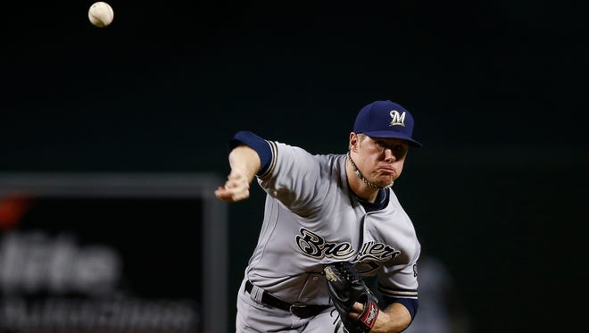 The Brewers' Chase Anderson throws a pitch against the Diamondbacks in the first inning.