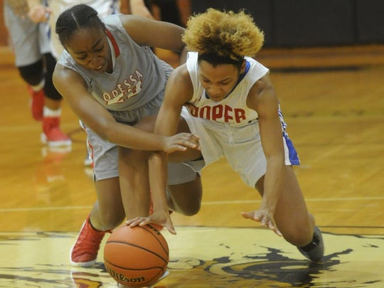Cooper's Calah Harvey, right, battles an Odessa High player for a loose ball. OHS beat the Lady Cougars 66-25 in the Consolation Bracket Championship game at the Polk-Key City Classic on Saturday, Nov. 19, 2016 at Abilene High's Eagle Gym.