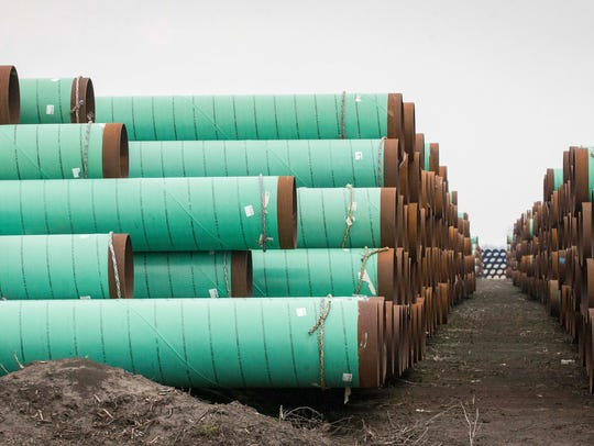 Enormous stacks of pipe stand in March, just east of