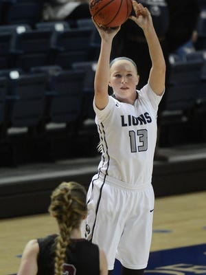 In this 2017 file photo, UAFS' Olivia Hanson nails a 3-pointer over Oklahoma Christian's defense at Stubblefield Center.