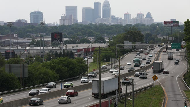 View of I-65 traffic near the U of L campus with a smoggy city skyline in the background.June 15, 2016