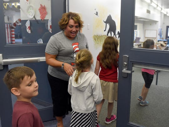 Tekoppel Elementary School teacher escorts her second grade students to the library at the school in Evansville Wednesday.  Dierks has worked 26 years with the Evansville Vanderburgh School Corp., 23 of those have been at Tekoppel.