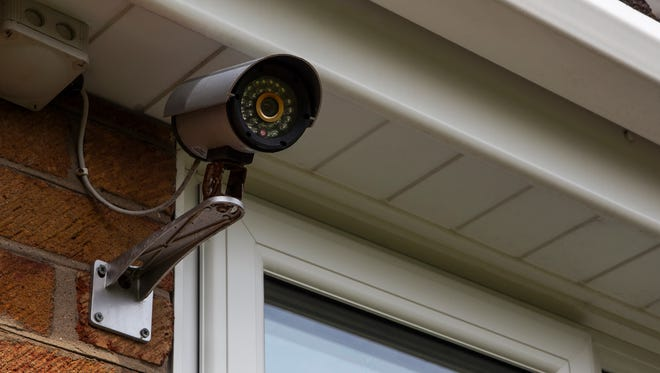 A CCTV security camera mounted on a house exterior wall could help police prevent and investigate crimes through Bridgewater Police Department's S.M.I.L.E. program.