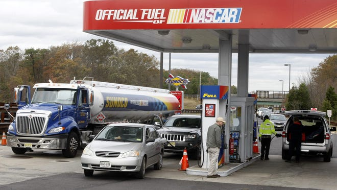 A Sunoco gasoline tanker pulls up to unload fuel as motorists wait in line for gasoline, at the Monmouth Service Area rest stop on the Garden State Parkway in Wall, New Jersey, Oct. 31, 2012.