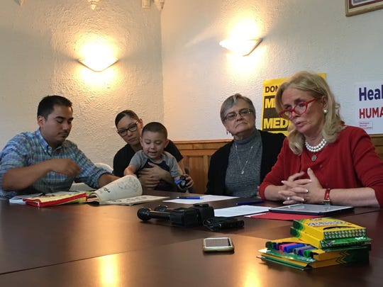 U.S. Rep. Debbie Dingell discusses issues with the GOP healthcare proposals on July 5, 2017. Sitting with her are Joyce Stein, a retired NICU nurse and Michigan Nurses Association member, David and Meghan Sanchez, and their son Benicio.