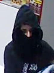 Police are searching for the suspect in an armed robbery