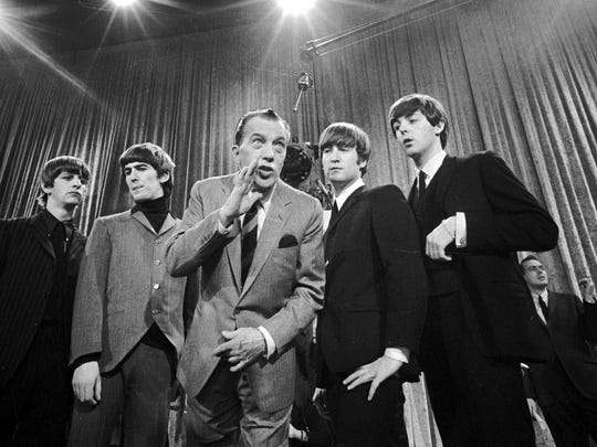 "In this Feb. 8, 1964 file photo, Ed Sullivan (center) stands with The Beatles (from left) Ringo Starr, George Harrison, John Lennon, and Paul McCartney, during a rehearsal for the British group's first American appearance, on the ""Ed Sullivan Show,"" in New York."