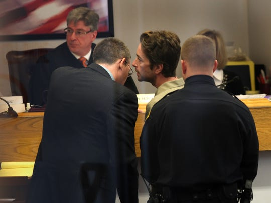 Scott Romero speaks with his attorney Christian Kennedy