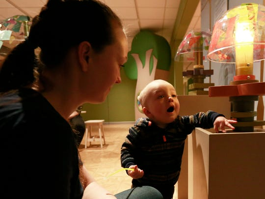 Joel Gilray, 17-month-old, plays with a toy lamp while his mother Kim looks on Friday during January Art Babies class at Leigh Yawkey Woodson Art Museum in Wausau.