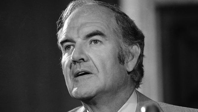 Sen. George McGovern speaks at a news conference in 1975.