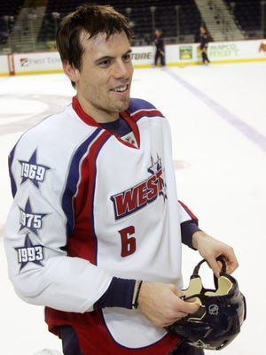 2009 All Star Game: Nashville Predators defenseman Shea Weber (6) fashions his new All-Star Western Conference team sweater for the media after being surprised by team mascot Gnash with the jersey during practice Jan. 7, 2009.