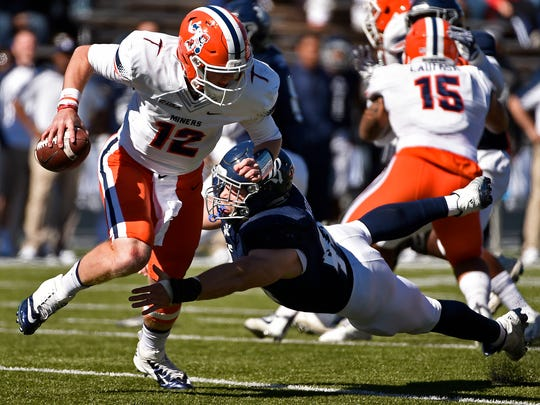 UTEP quarterback Ryan Metz (12) is sacked by Rice defensive end Brian Womac during the first half of an NCAA college football game, Saturday, Nov. 19, 2016, in Houston.