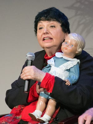 Inge Auerbacher speaks during the Federal Inter-Agency Holocaust Remembrance Day on April 17, 2013, in Washington, D.C. She holds a replica of child doll Marlene that she was able to keep with her for several decades.