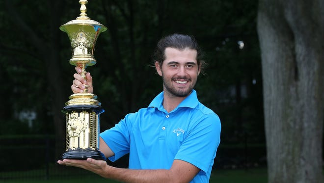 Curtis Luck from Australia celebrates with the Havemeyer Trophy after defeating Brad Dalke from Norman, Oklahoma 6-4 to win the U.S Amateur Championship Saturday played on the South Course of Oakland Hills Country Club.