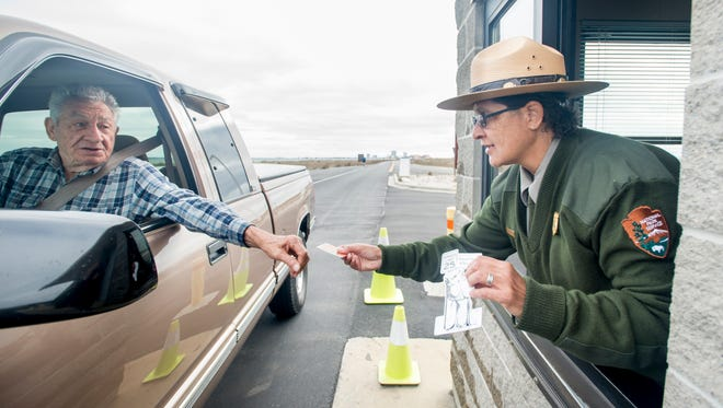 National park ranger Renee Jones hands out chick magnets at the entrance to Fort Pickens on Wednesday, March 8, 2017.
