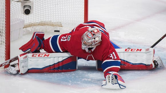 Montreal Canadiens goaltender Carey Price gives up a goal to Edmonton Oilers' Jujhar Khaira during the second period of an NHL hockey game Saturday, Dec. 9, 2017, in Montreal. (Graham Hughes/The Canadian Press via AP)