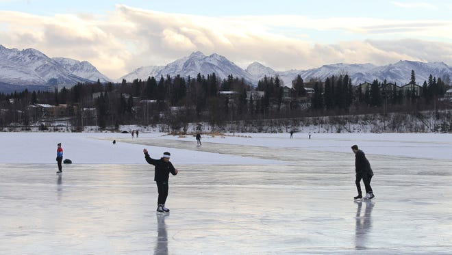 Ice skaters take advantage of unseasonable warm temperatures to ice skate outside at Westchester Lagoon in Anchorage, Alaska, on Jan. 2. The Arctic just finished its warmest winter on record, with plenty of open water where the ocean normally freezes.