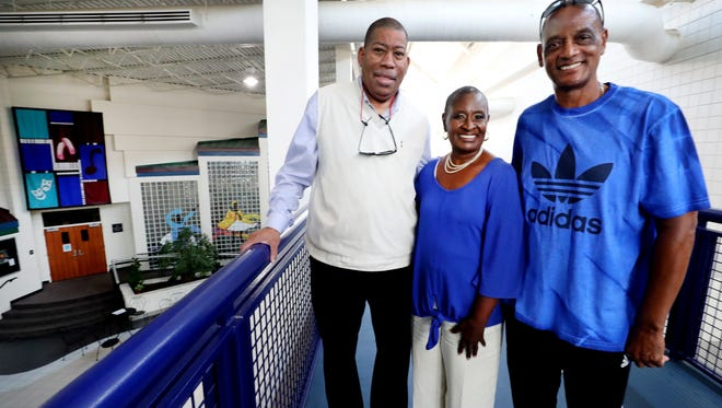 Ron Washington, left, Gloria Bonner and Pierre Lyons stand on the track at Patterson Park Community Center, which will celebrate 15 years in its expanded facilities on Saturday.