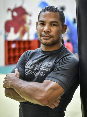 """Professional mixed marital artist Baby Joe """"The Juggernaut"""" Tamianglo, 31, from Talofofo, gets ready to train at the iFit gym in Tamuning on Aug. 5."""