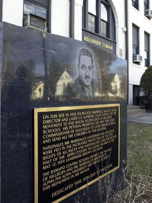 A monument commemorating Thurgood Marshall and a 1943 desegregation case stands in front of the former Main School in Hillburn.