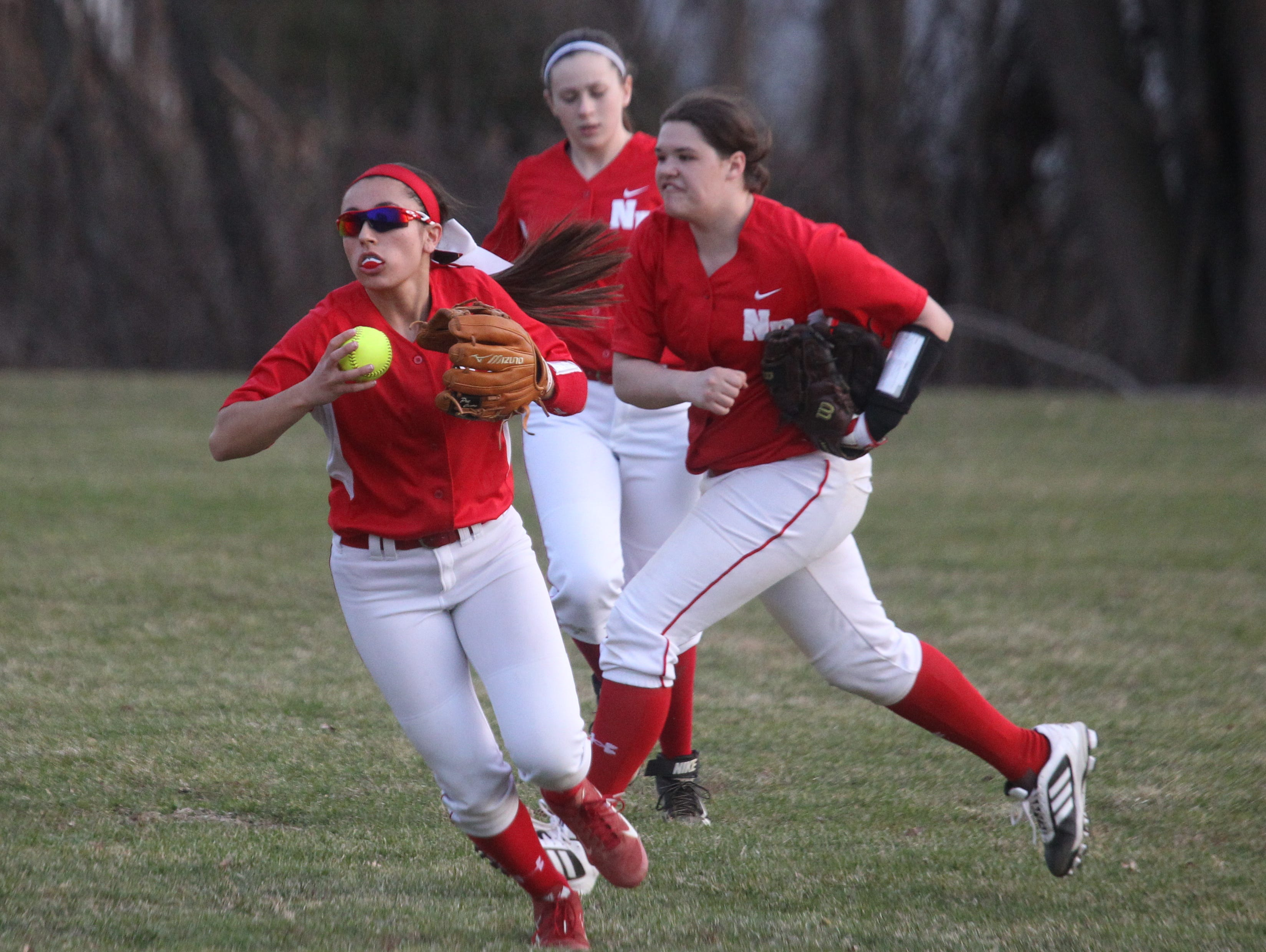 North Rockland's Victoria Alonso (front) and Amanda Schweitzer (middle) are two of several returning softball players for the Red Raiders this year.