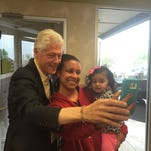 Former president Bill Clinton takes a photo with Paulisha Vandiver, 30, and her daughter Maleah, 2, at Cone Palace in Kokomo, Ind., on Saturday, April 30, 2106. Clinton was campaigning for his wife, Democratic presidential candidate Hillary Clinton.