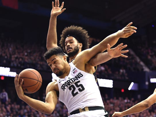 Michigan State Spartans forward Kenny Goins (25) grabs