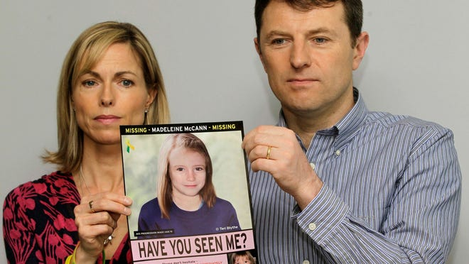 FILE - In this May 2, 2012 file photo, Kate and Gerry McCann pose for the media with a missing poster depicting an age progression computer generated image of their daughter Madeleine at nine years of age, to mark her birthday and the 5th anniversary of her disappearance during a family vacation in southern Portugal in May 2007, during a news conference in London. Madeleine McCann's family is hoping for closure in the case after a key suspect was identified in Germany and as authorities there say they believe the missing British girl is dead.