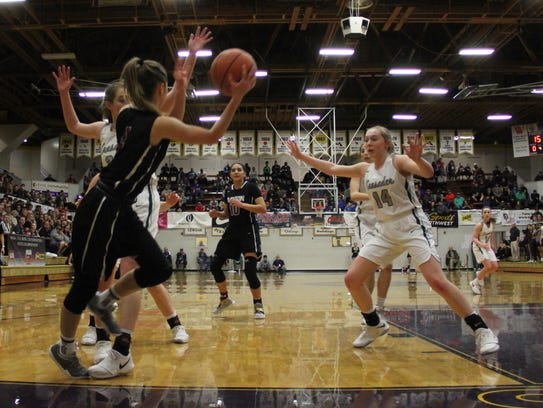 Dayton's Malina Ray throws the ball back inbounds against
