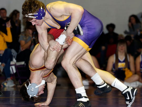 Northern Iowa's Taylor Lujan, top, dominates Iowa State's