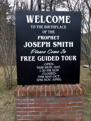 A sign marks the birthplace of Mormonism founder Joseph Smith in Sharon, Vt.