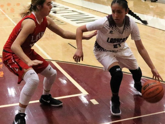 Tularosa's Brynn Martinez, right, tries to dribble
